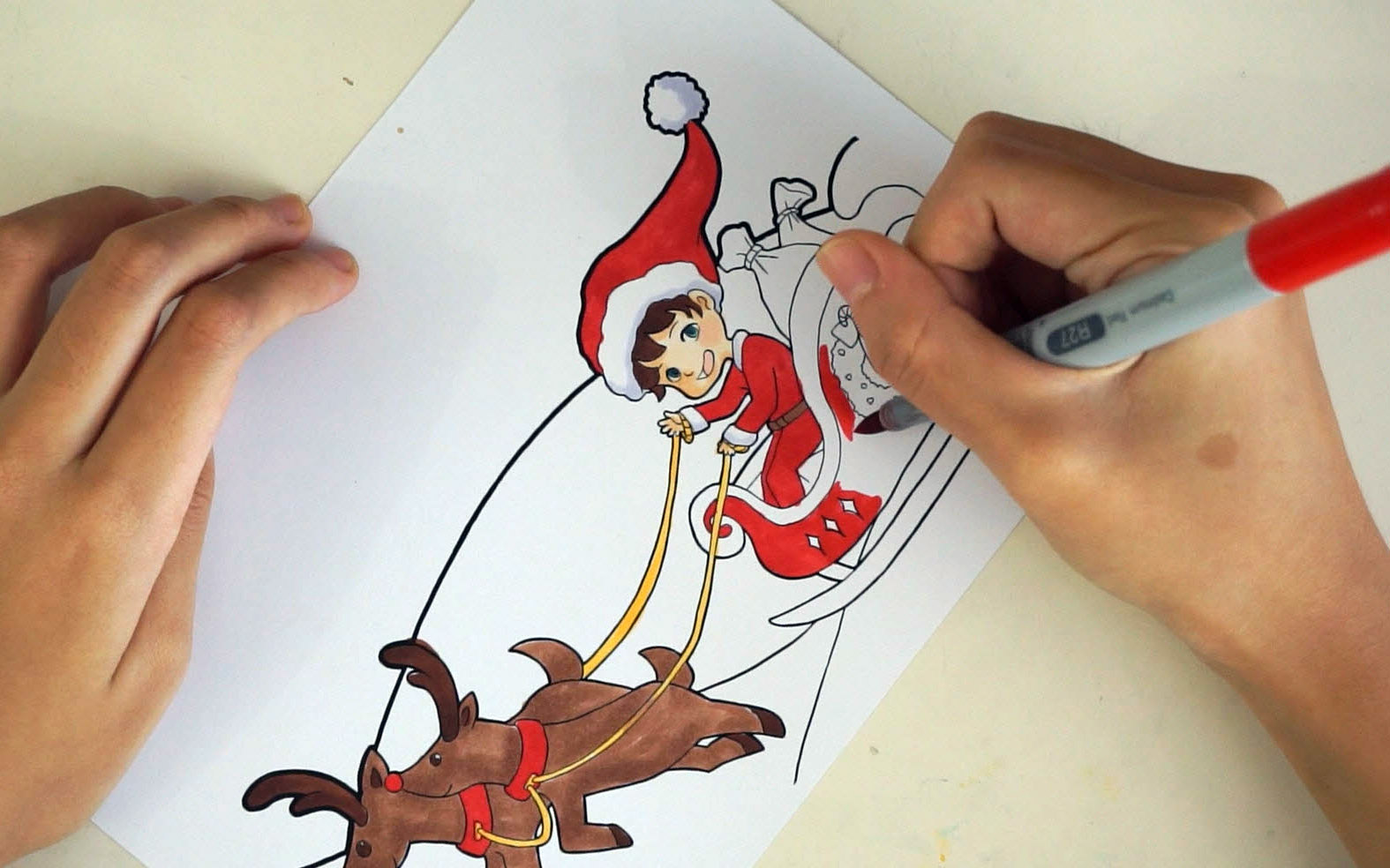 Coloring in the foreground of the holiday template.