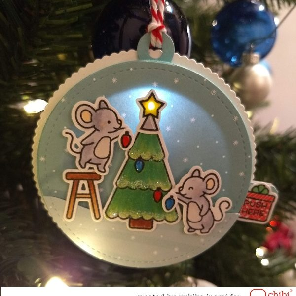 The Light Up Music Box Tag