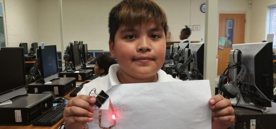 4th grader building simple circuit LED light circuit sticker