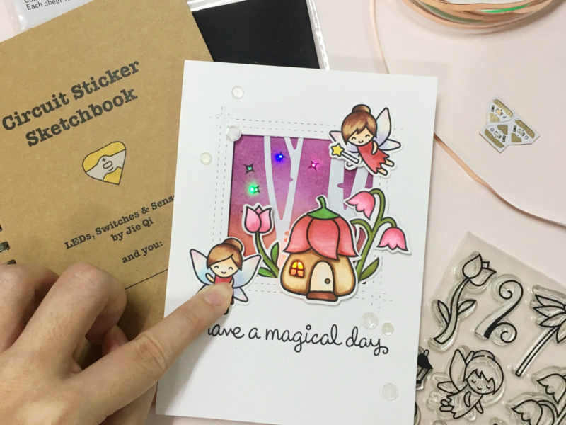 Light up card using pressure sensitive conductive plastic