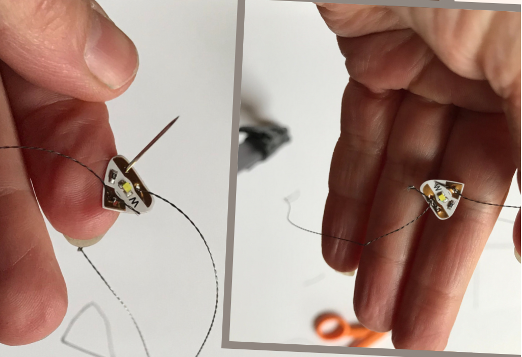 conductive thread sewn to and tied around the pad of a circuit sticker